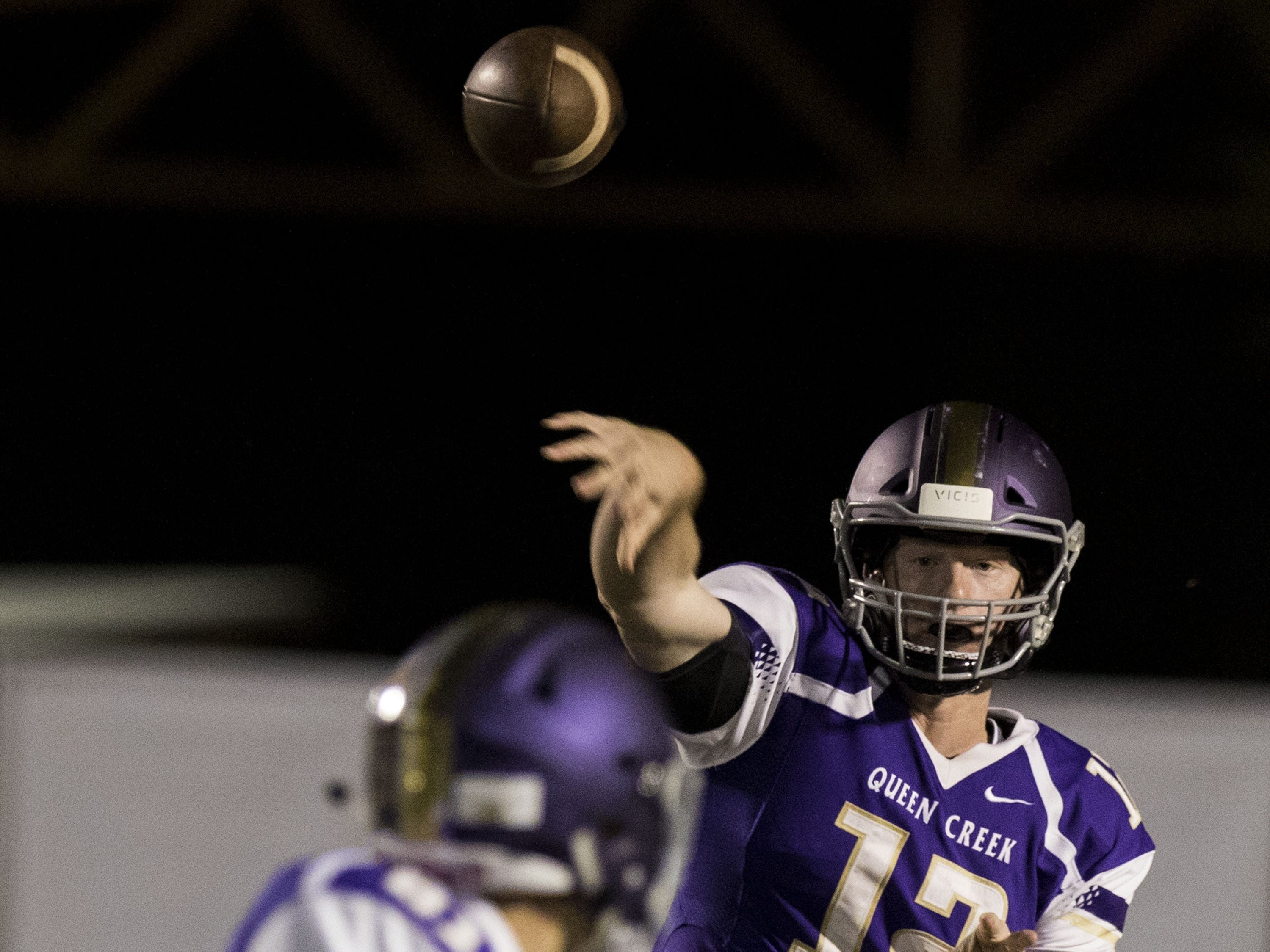 Queen Creek quarterback Devin Larsen throws a pass during their game against Highland in Queen Creek Friday, Oct. 19, 2018. #azhsfb