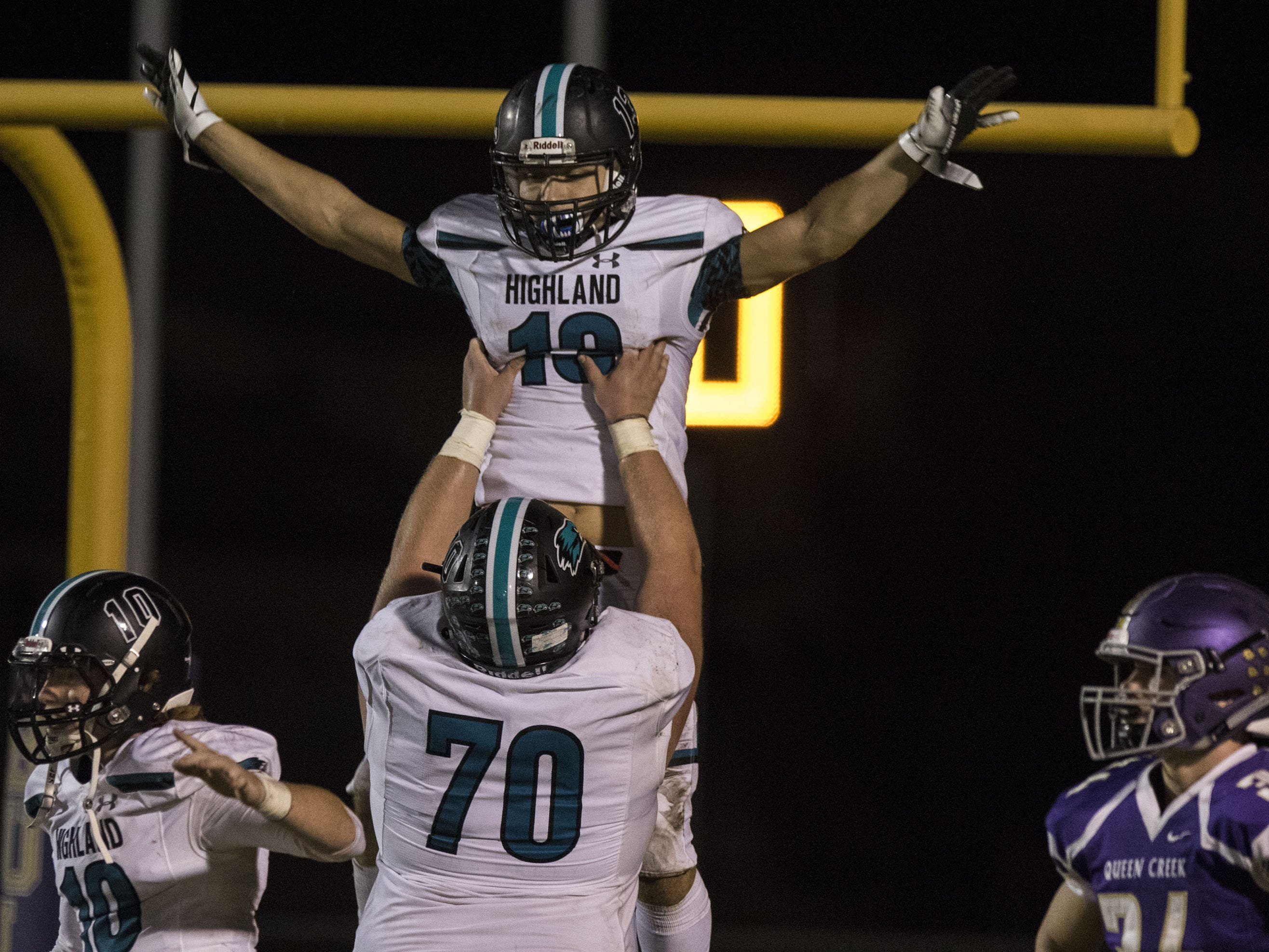 Highland's Cody Zimmerman gets lifted in the air by lineman Caleb Allen after scoring a touchdown against Queen Creek during their game Friday, Oct. 19, 2018. #azhsfb