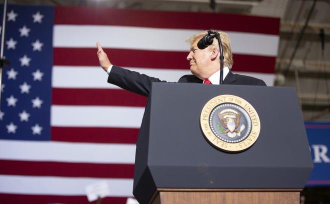 President Donald Trump speaks during a Make America Great Again Rally at International Air Response Hangar at Phoenix-Mesa Gateway Airport on Oct. 19, 2018.