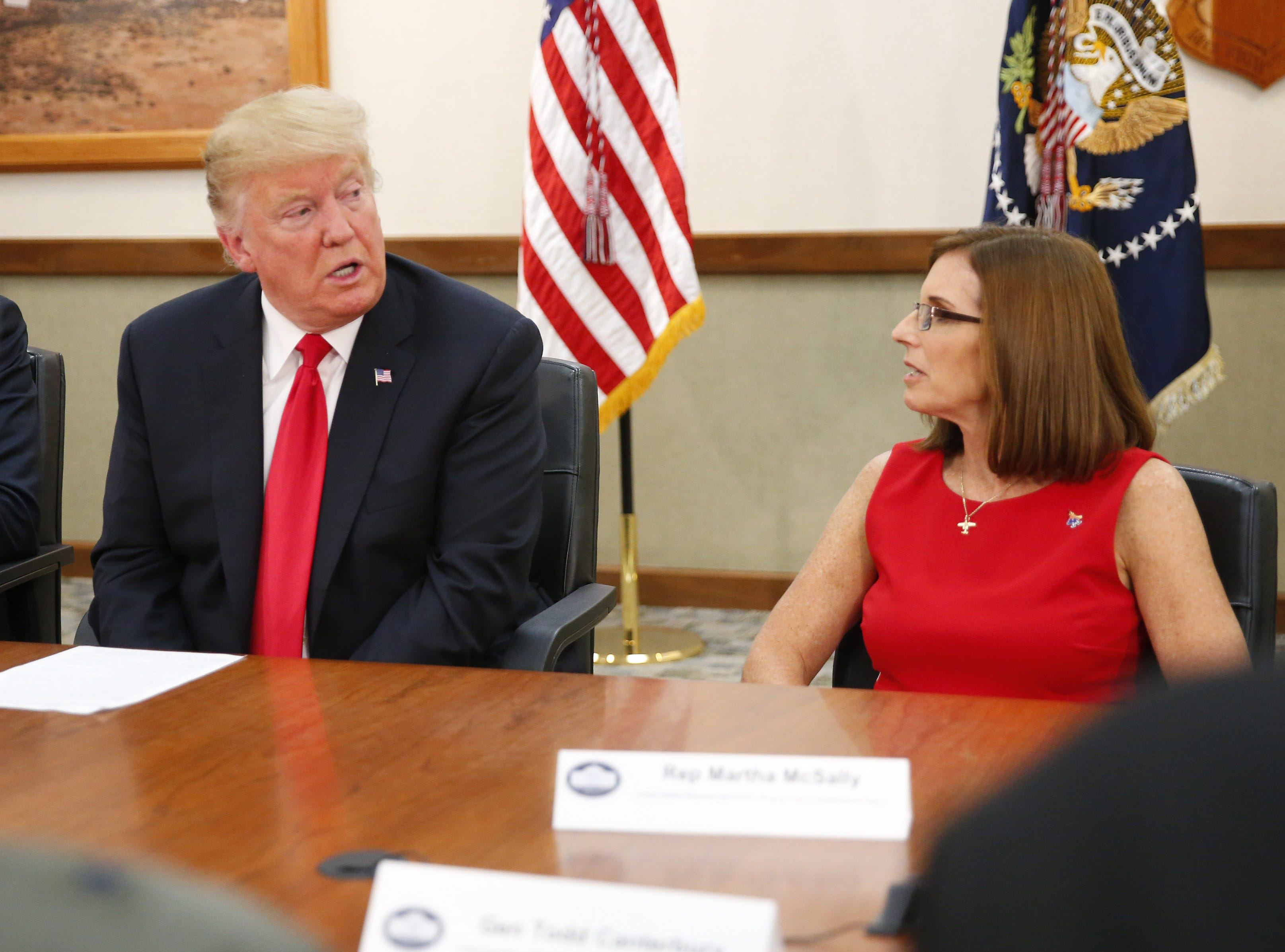 President Trump and Rep. Martha McSally talk during a round-table discussion at Luke Air Force Base in Glendale on Oct. 19, 2018.