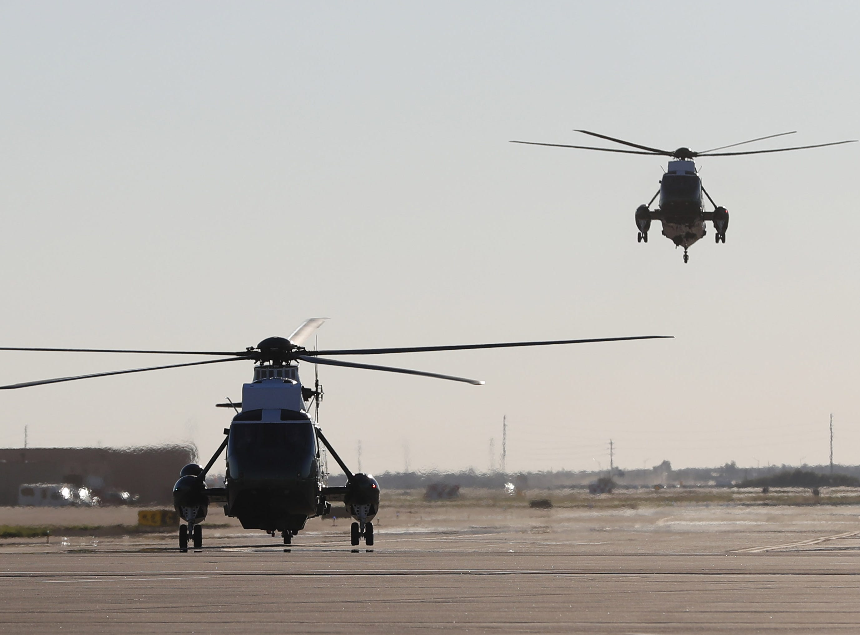 Marine One (right), with President Trump, lands at Luke AFB for a defense capability tour and round-table discussion in Glendale on Oct. 19, 2018.