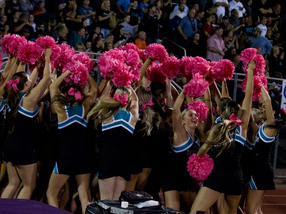 Highland cheerleaders do a touchdown dance after their team scored against Queen Creek Friday, Oct. 19, 2018. #azhsfb