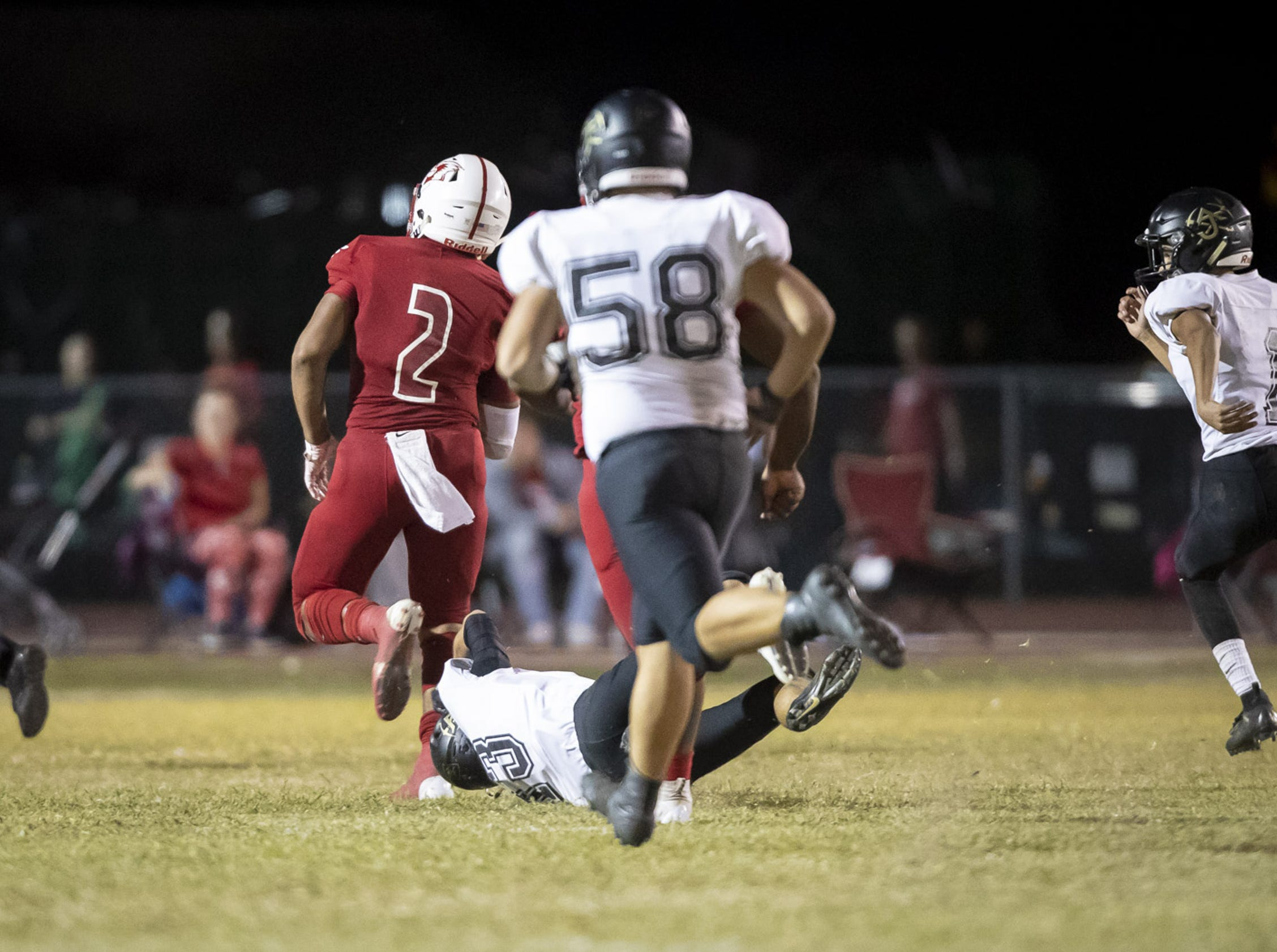 Junior running back Kevin Daniels (2) of the Glendale Cardinals runs the ball in the end-zone for a touchdown against the Apache Junction Prospectors at Glendale High School on Friday, October 19, 2018 in Glendale, Arizona. #azhsfb