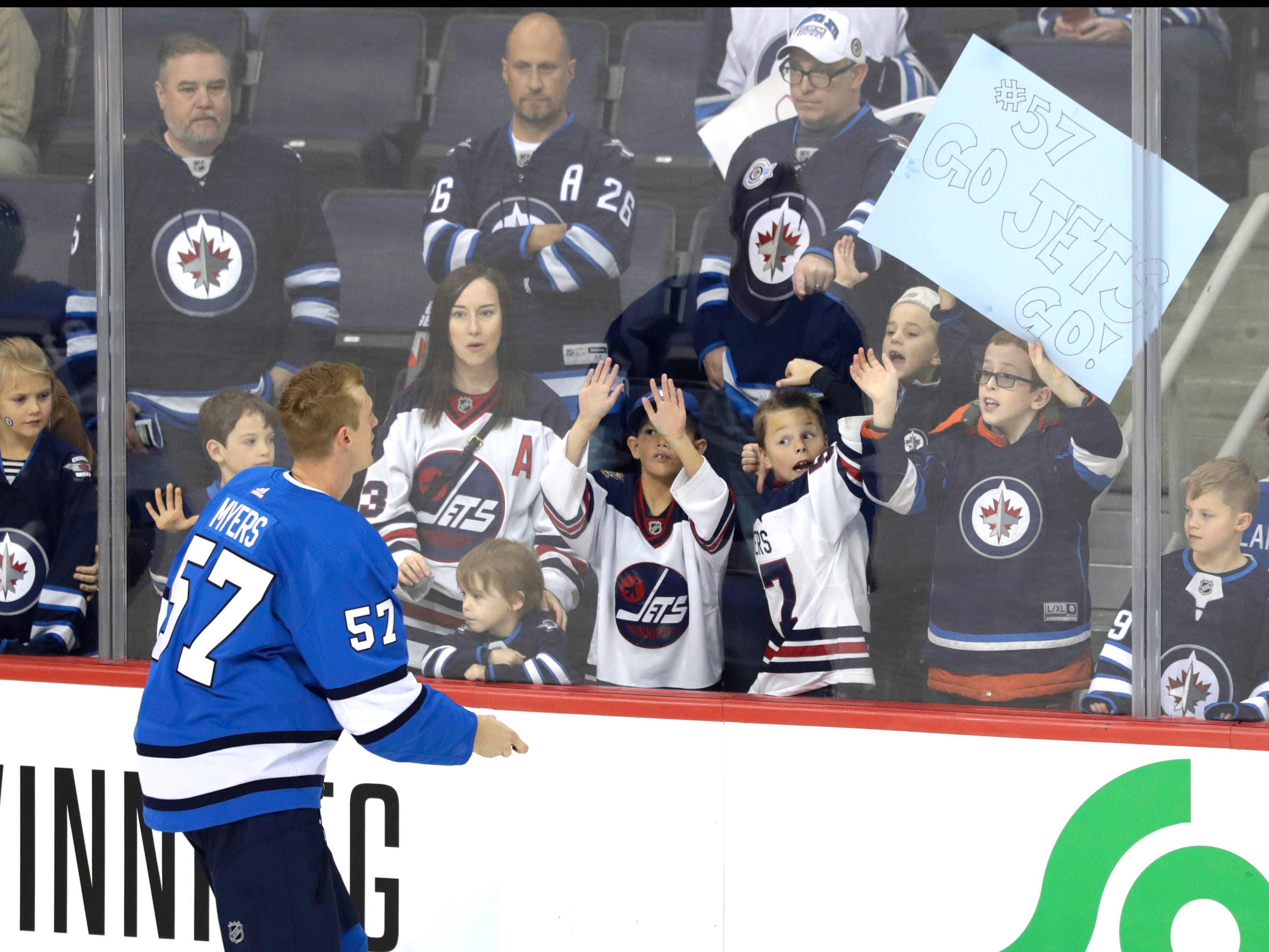 Oct 20, 2018; Winnipeg, Manitoba, CAN; Winnipeg Jets defenseman Tyler Myers (57) tosses a puck to fans before a game against Arizona Coyotes at Bell MTS Place. Mandatory Credit: James Carey Lauder-USA TODAY Sports