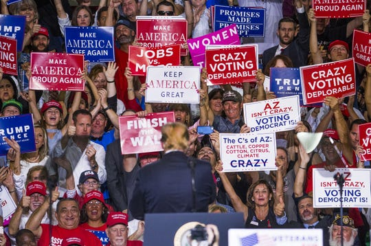 The crowd cheers for President Donald Trump at the International Air Response Hangar at Phoenix-Mesa Gateway Airport on Oct. 19, 2018.