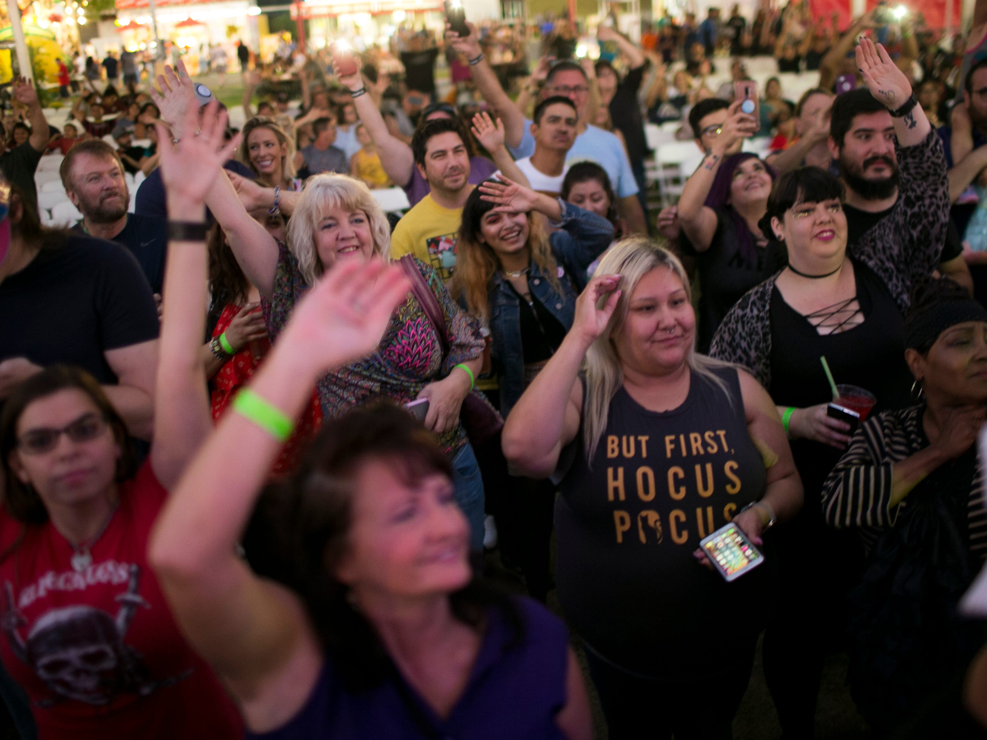 Fans dance along to Mini Kiss as they perform at the Arizona State Fair in Phoenix on Saturday, Oct. 6, 2018.