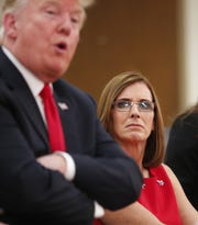Then-Rep. Martha McSally with President Donald Trump at Luke Air Force Base in Glendale in October.