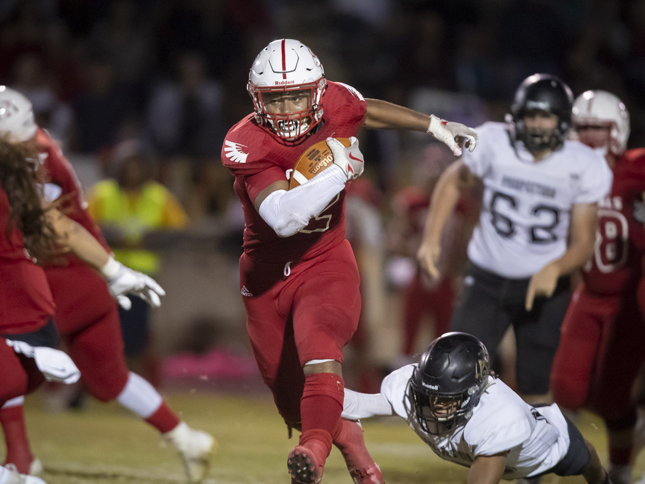 Junior running back Kevin Daniels (2) of the Glendale Cardinals runs the ball against the Apache Junction Prospectors at Glendale High School on Friday, October 19, 2018 in Glendale, Arizona. #azhsfb