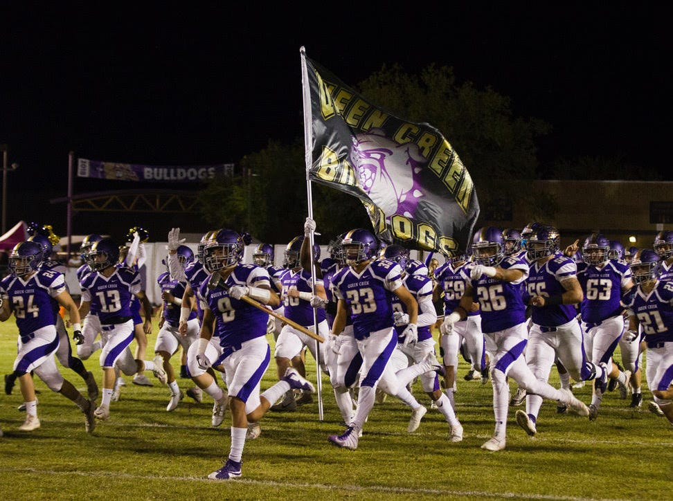 Queen Creek players run out onto the field before their game with Highland Friday, Oct. 19, 2018. #azhsfb