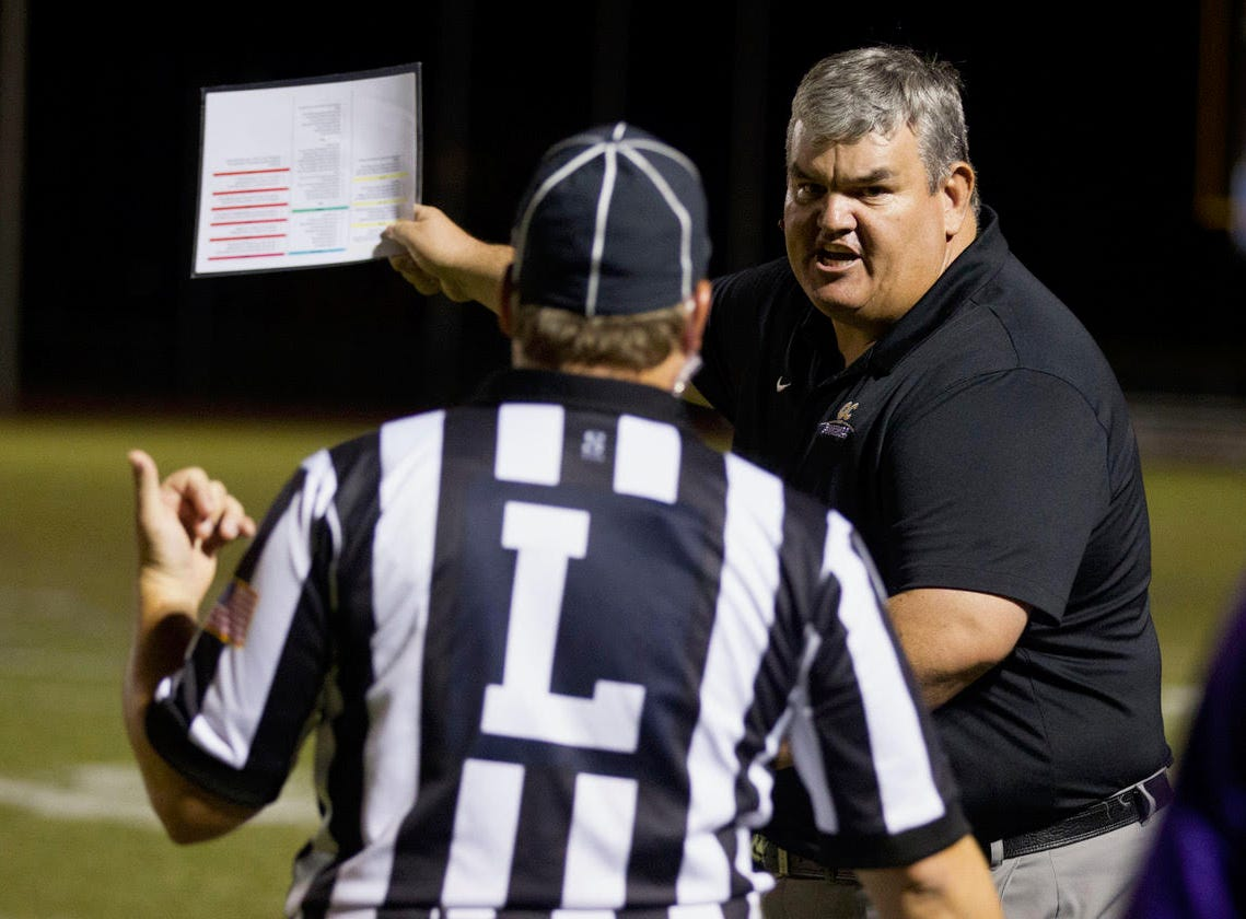 Queen Creek head coach Travis Schureman has words with a referee after a late hit on his quarterback during their game against Highland  Friday, Oct. 19, 2018. #azhsfb