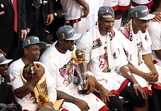 The Miami Heat celebrate winning the 2012 NBA championship, the first of LeBron James' three NBA titles.