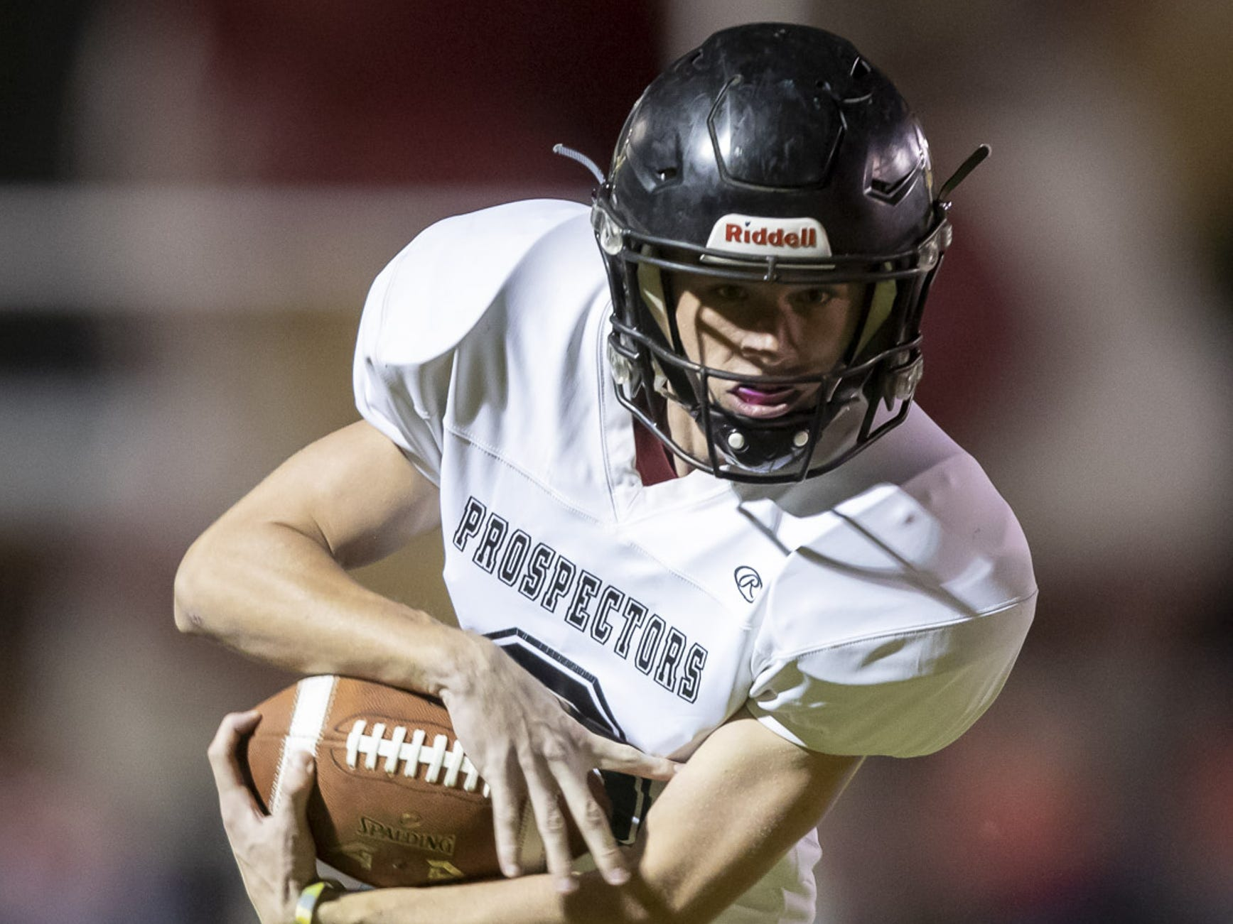 Junior wide receiver Tommy Ryan (6) of the Apache Junction Prospectors runs the ball against the Glendale Cardinals at Glendale High School on Friday, October 19, 2018 in Glendale, Arizona. #azhsfb