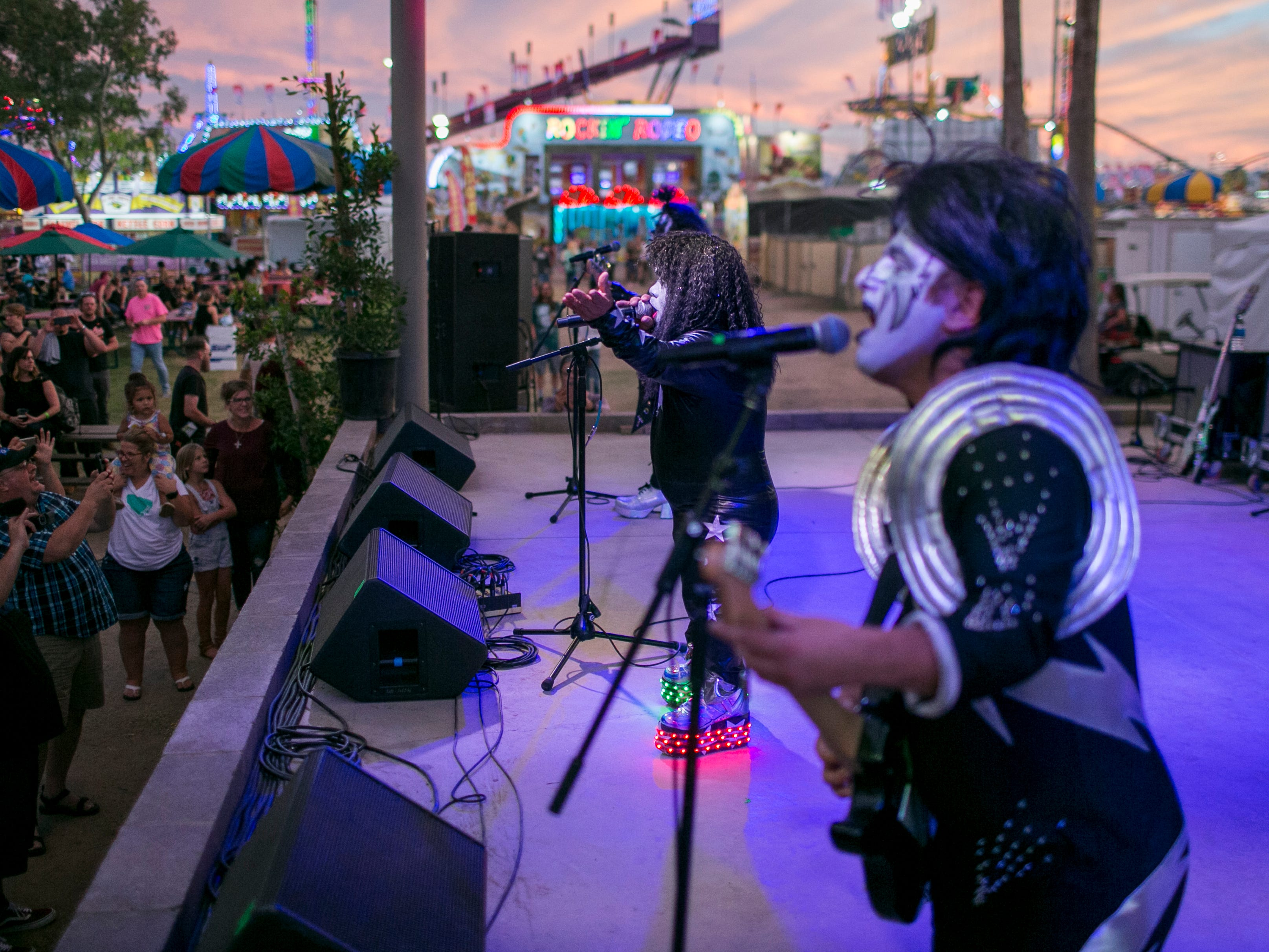 Mini Kiss performs on stage at the Arizona State Fair in Phoenix on Saturday, Oct. 6, 2018.