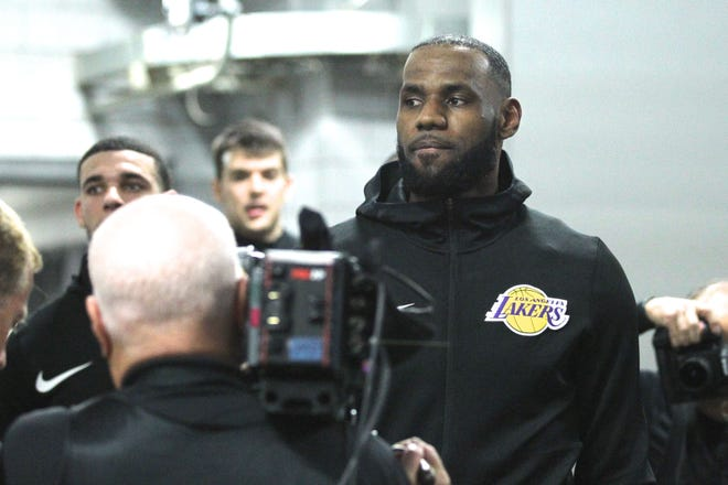LeBron James gets ready to walk onto the court for his first game with the Lakers at the Moda Center in Portland. The Lakers lost to the Trail Blazers 128-119.