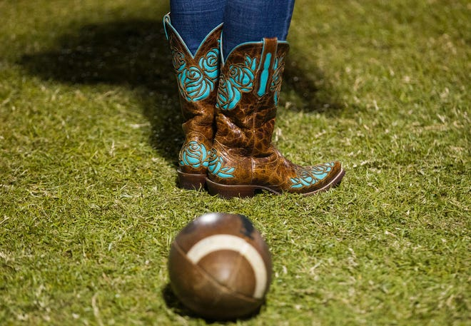 Cowboy boots and football are popular out in Queen Creek as their Bulldogs play the Highland Hawks Friday, Oct. 19, 2018. #azhsfb