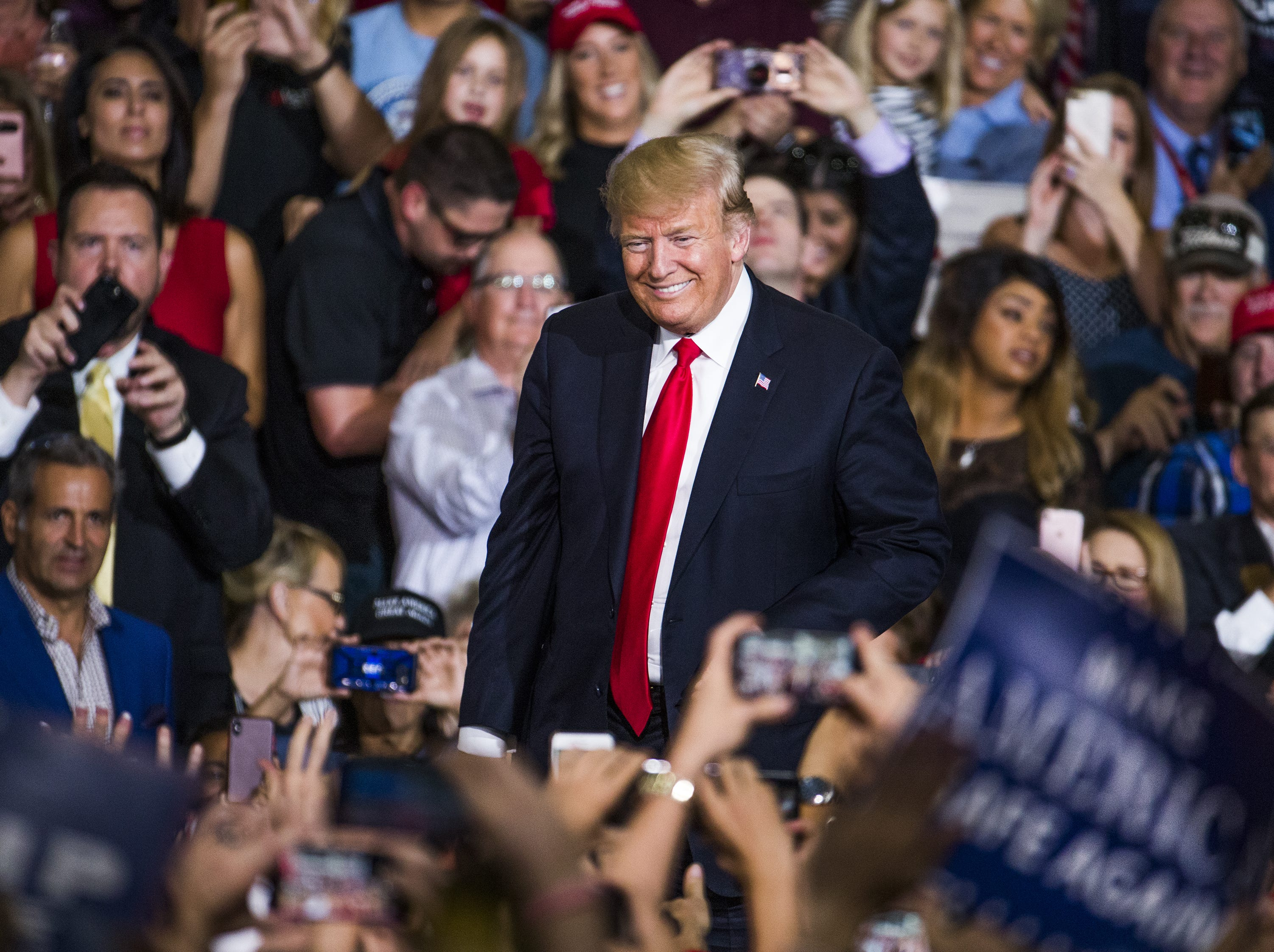 President Donald Trump enters the International Air Response Hangar at Phoenix-Mesa Gateway Airport for a rally for Rep. Martha McSally on Oct. 19, 2018.