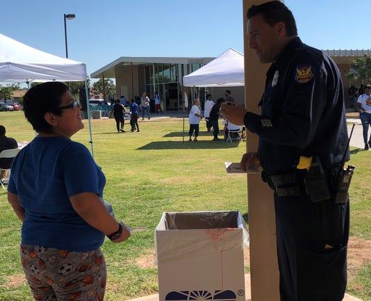 Cop Talks To Kid