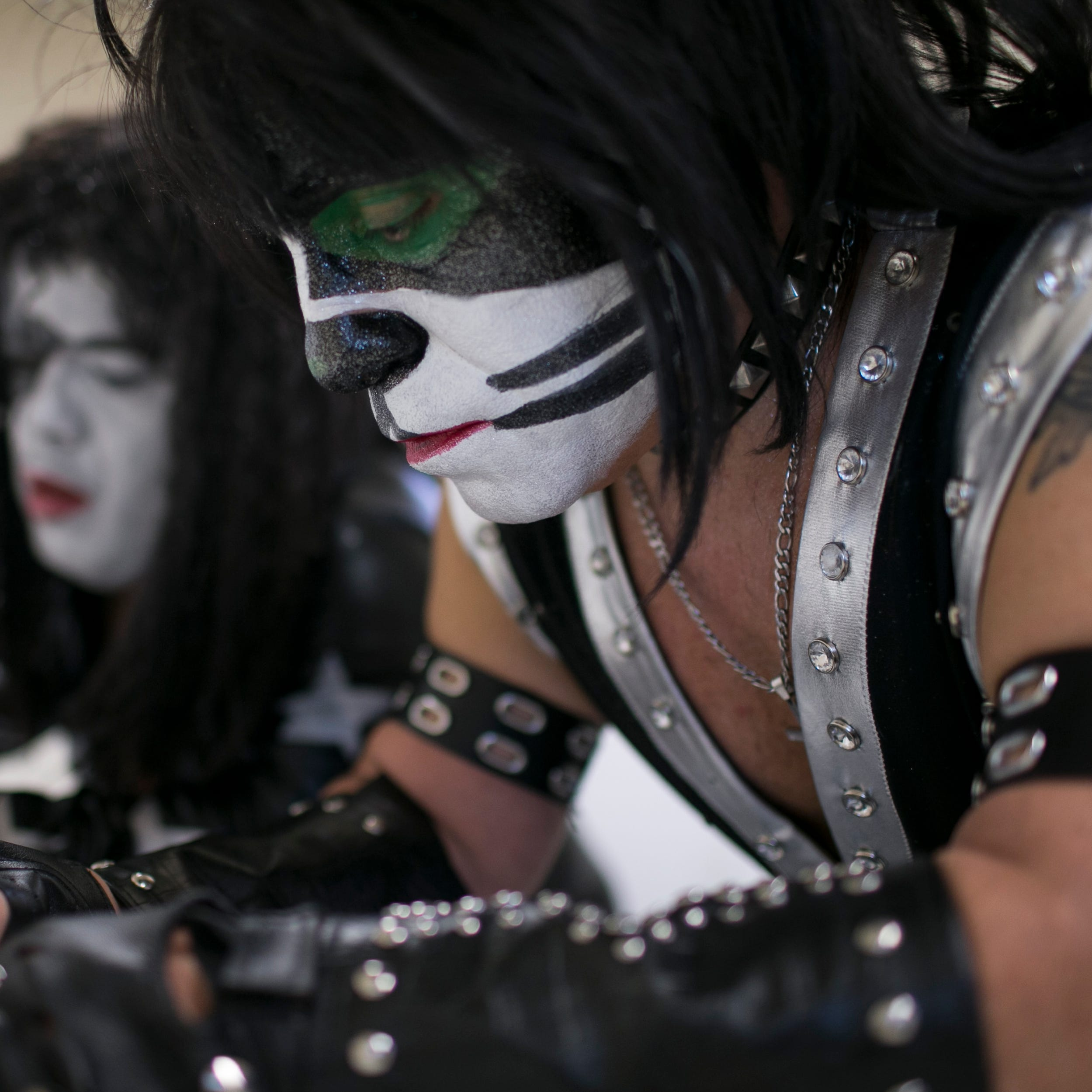 Mini Kiss band overcomes sadness to entertain the Arizona State Fair crowd