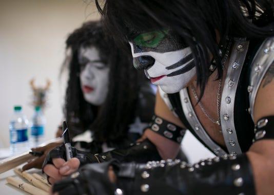 Mini Kiss tribute band members show