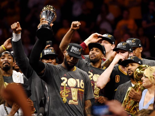 LeBron James celebrates with his Cavaliers teammates after winning an NBA title for Cleveland in 2016.