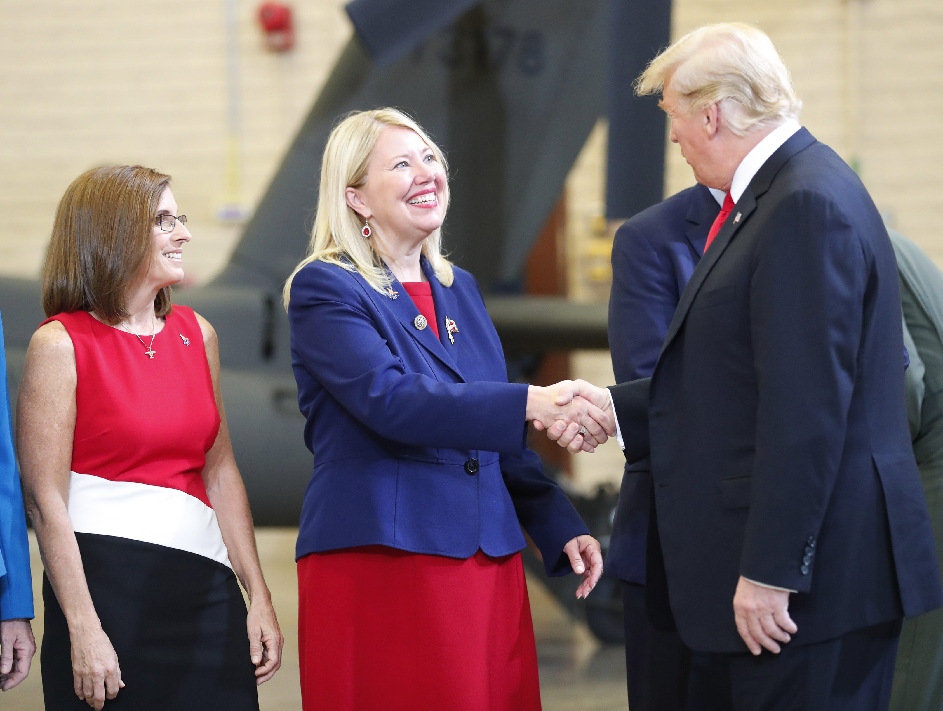 President Trump shakes hands with Rep. Debbie Lesko during a defense capability tour and round-table discussion at Luke Air Force Base in Glendale on Oct. 19, 2018.
