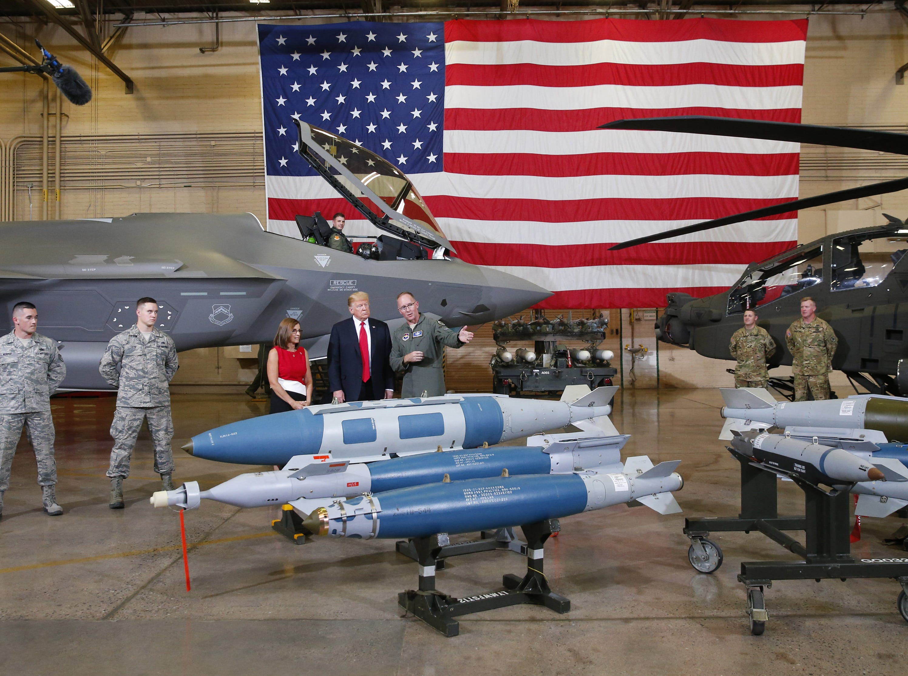 President Trump and Rep. Martha McSally are shown munitions during a defense capability and round-table tour at Luke Air Force Base in Glendale on October 19, 2018.