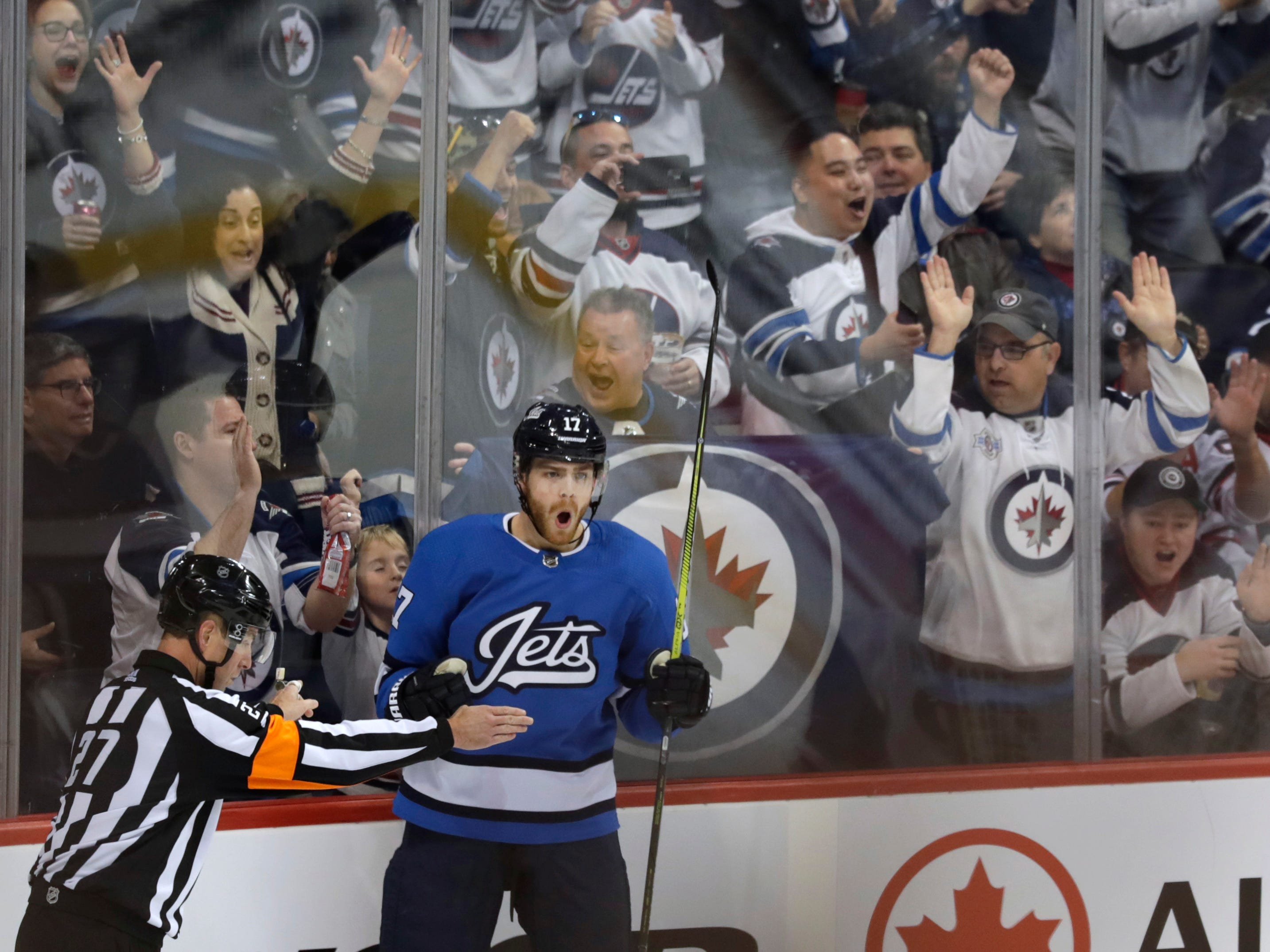 Oct 20, 2018; Winnipeg, Manitoba, CAN; Winnipeg Jets center Adam Lowry (17) celebrates his first period goal against Arizona Coyotes at Bell MTS Place. Mandatory Credit: James Carey Lauder-USA TODAY Sports