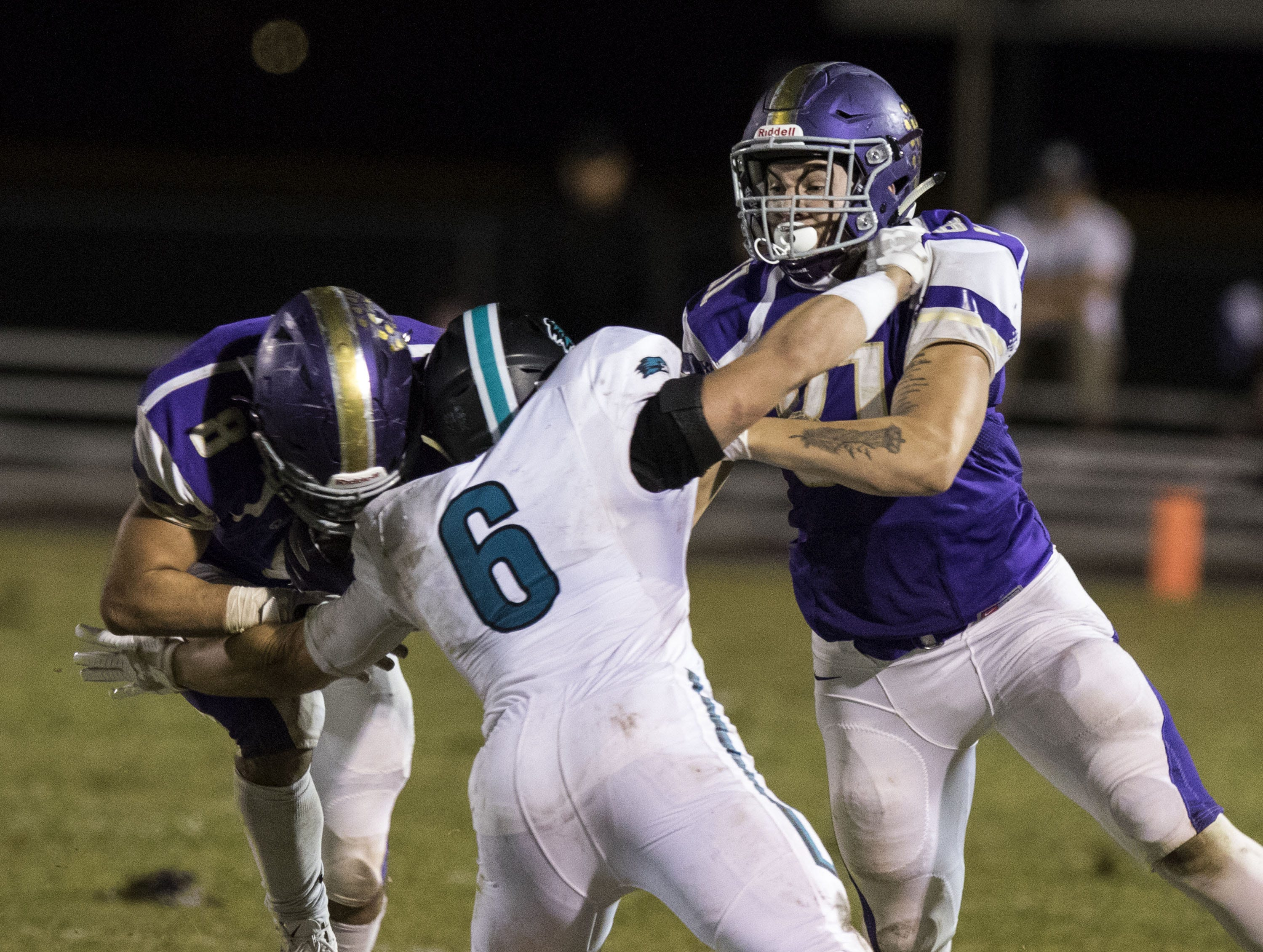 Highland's Daniel Wood gets blocks and makes a tackle at the same time against Queen Creek's Dylan Borja during their game in Queen Creek Friday, Oct. 19, 2018. #azhsfb
