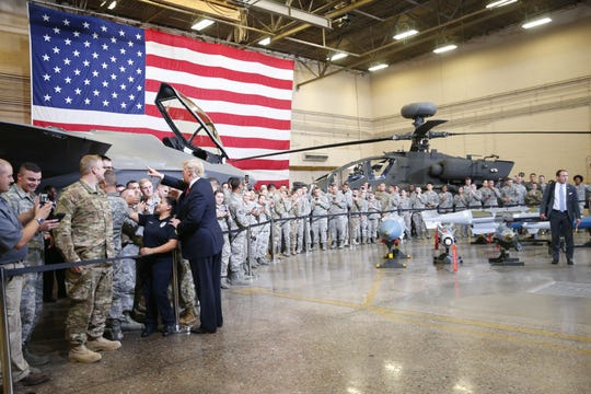 President Donald Trump greet airmen during a defense capability tour at Luke Air Force Base in Glendale, on Oct. 19, 2018.