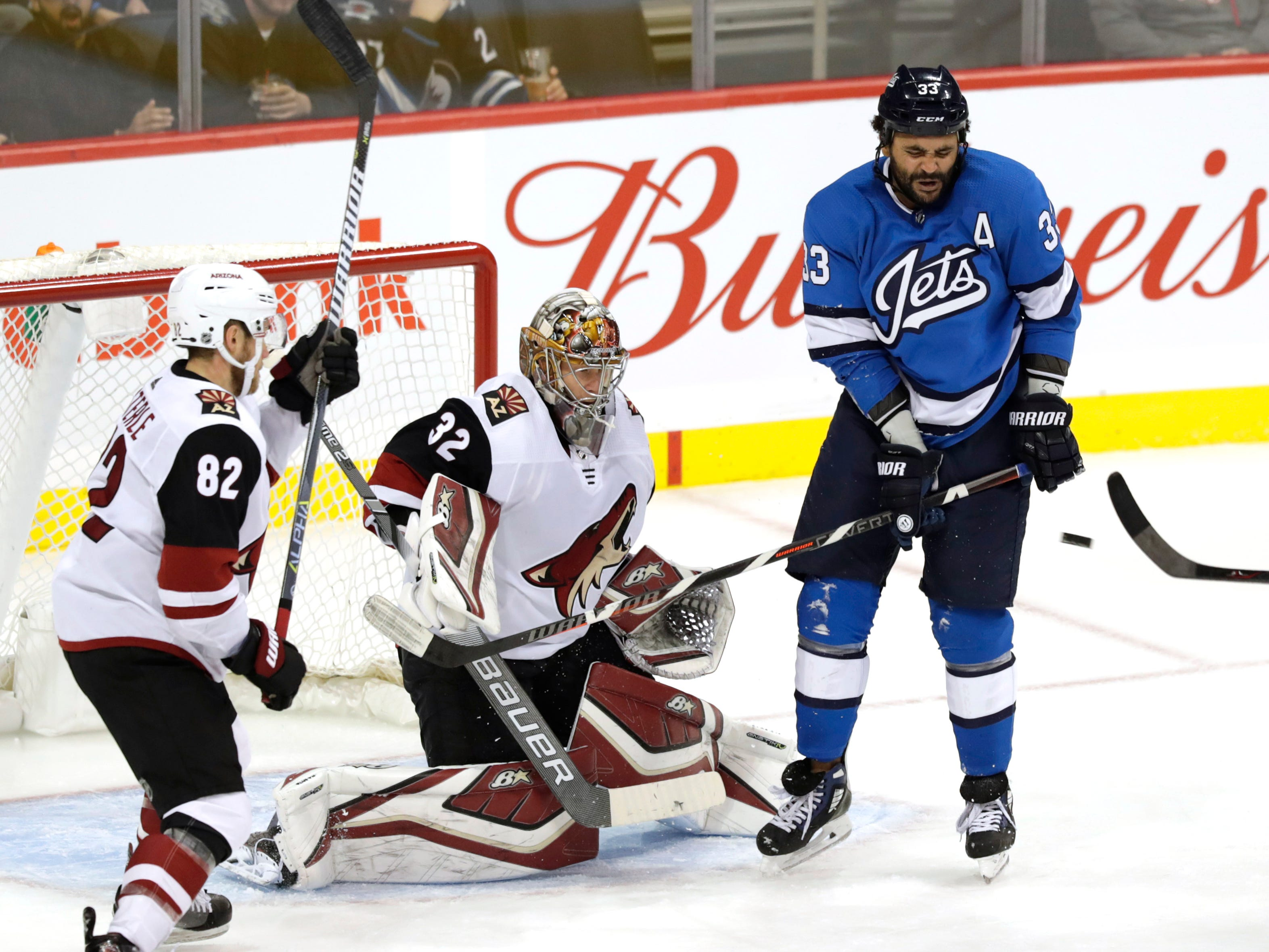 Oct 20, 2018; Winnipeg, Manitoba, CAN; Winnipeg Jets defenseman Dustin Byfuglien (33) screens Arizona Coyotes goaltender Antti Raanta (32) in the first period at Bell MTS Place. Mandatory Credit: James Carey Lauder-USA TODAY Sports