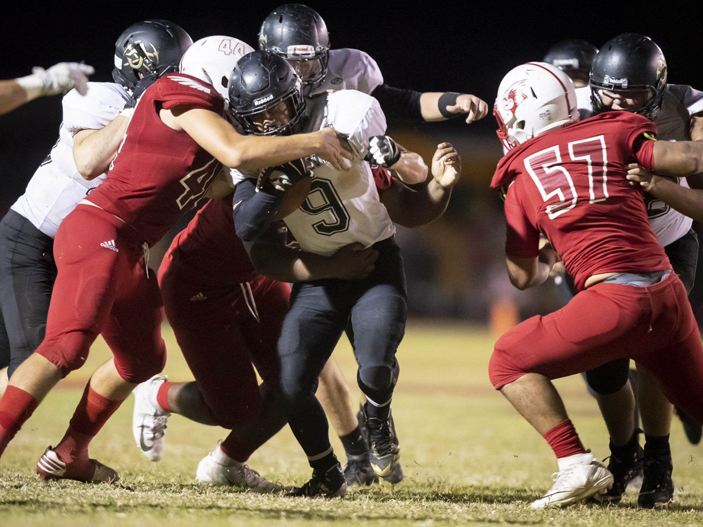 Senior running back William Lohman (9) of the Apache Junction Prospectors runs the ball against the Glendale Cardinals at Glendale High School on Friday, October 19, 2018 in Glendale, Arizona. #azhsfb