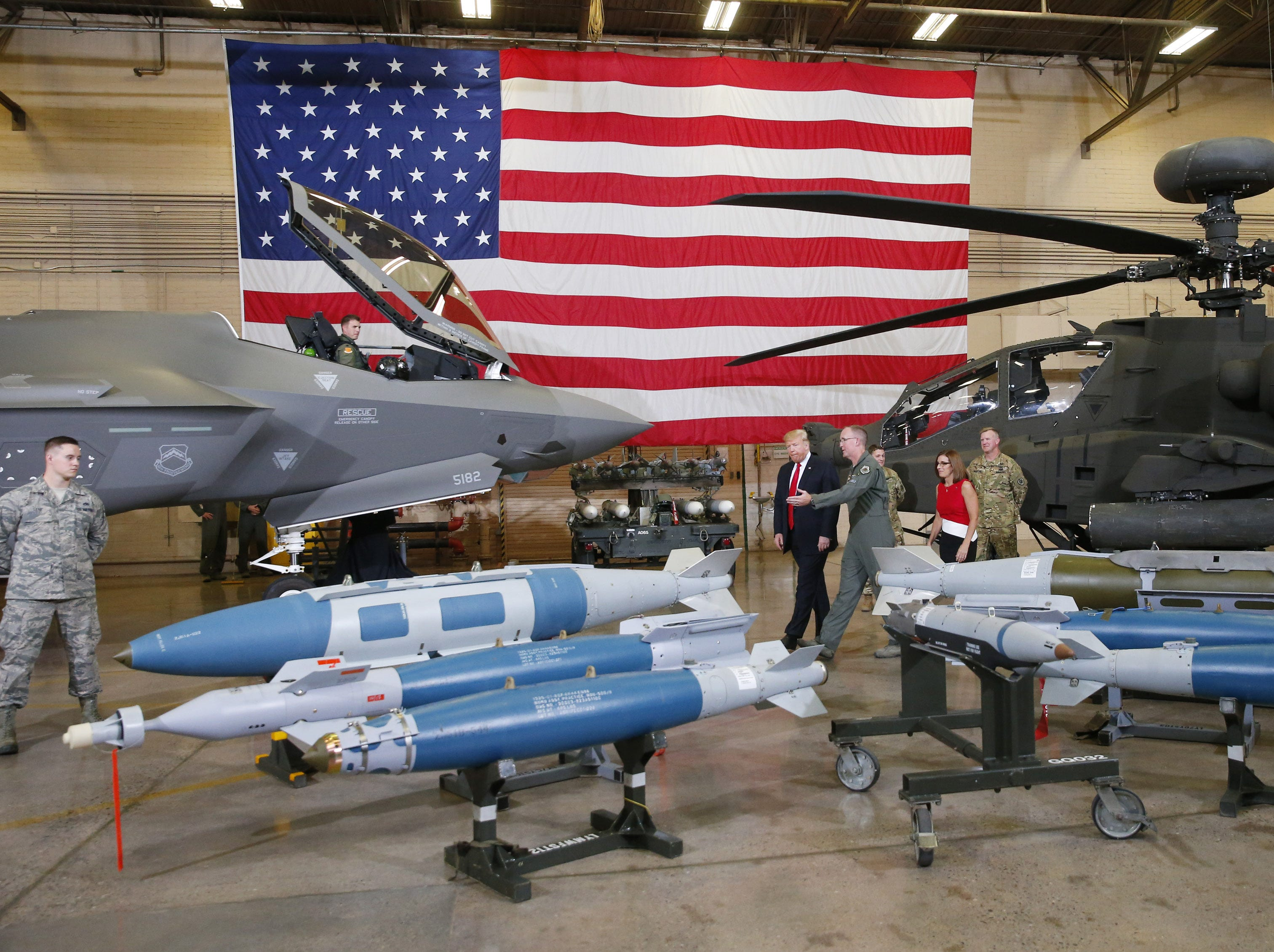 Gen. Todd Canterbury, 56th fighter wing commander, gives a tour to President Donald Trump at Luke Air Force Base in Glendale on Oct. 19, 2018.