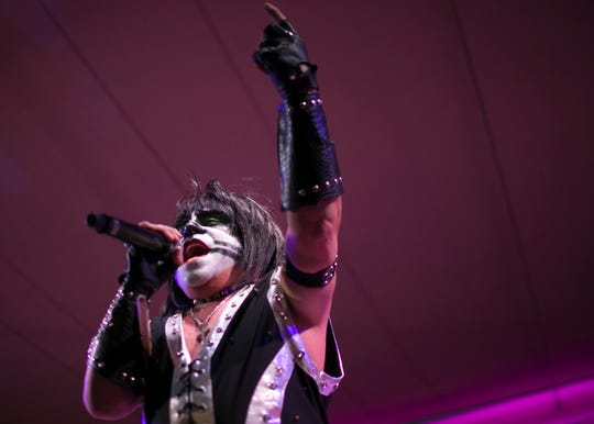 "Mark Mingolo, dressed as ""Mini-Peter,"" performs with Mini Kiss at the Arizona State Fair in Phoenix on Saturday, Oct. 6, 2018."