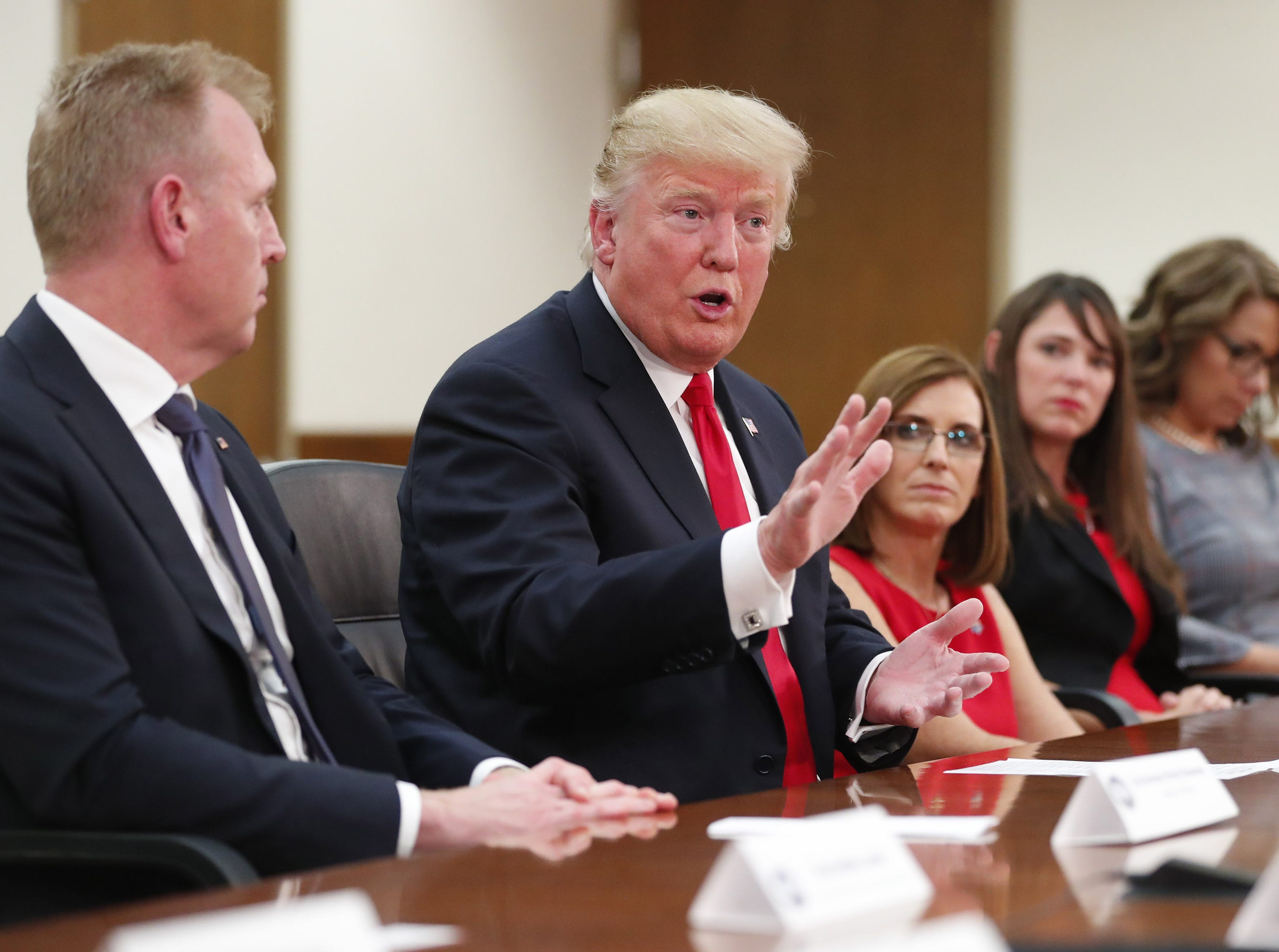 President Donald Trump answers a question on immigration during a round-table discussion at Luke Air Force Base in Glendale on Oct. 19, 2018.