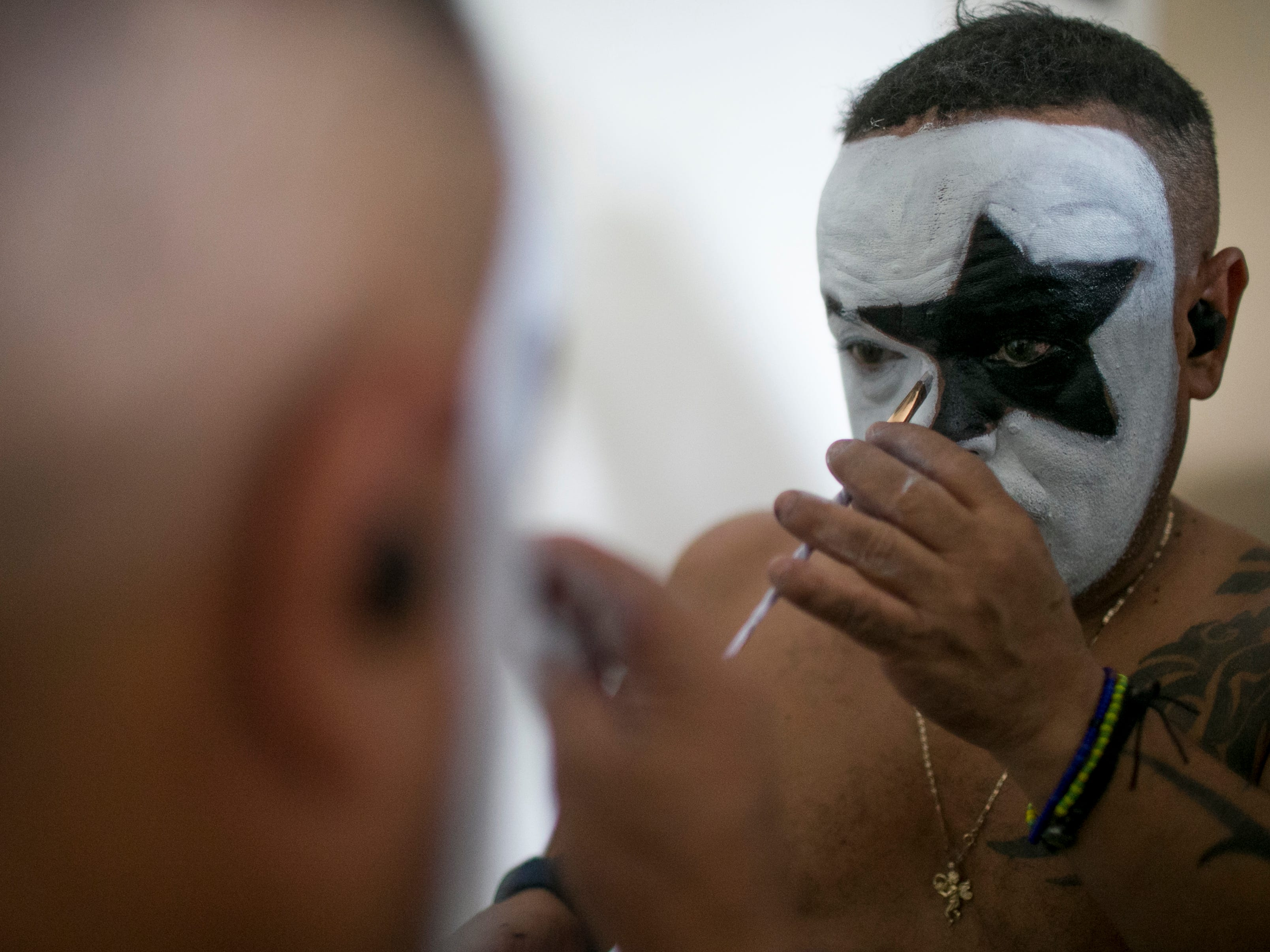 "Pablo Montavlo puts on face makeup before performing with the group, Mini Kiss, at the Arizona State Fair in Phoenix on Saturday, Oct. 6, 2018. Montavlo was performing as ""Mini-Paul"" for the show that night."