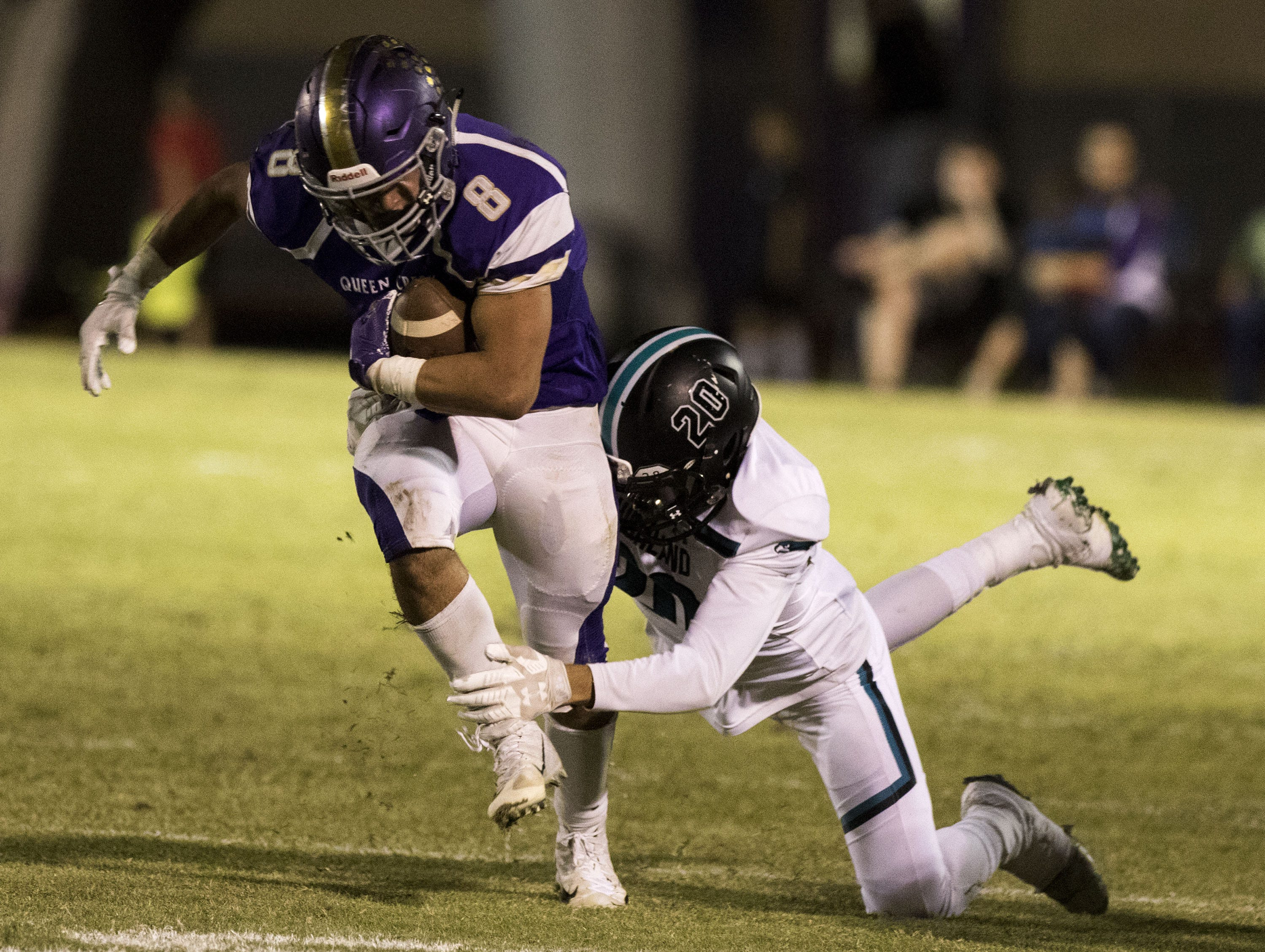 Queen Creek's Dylan Borja gets wrapped up by Highland's Ryan Martinez during them game in Queen Creek Friday, Oct. 19, 2018. #azhsfb
