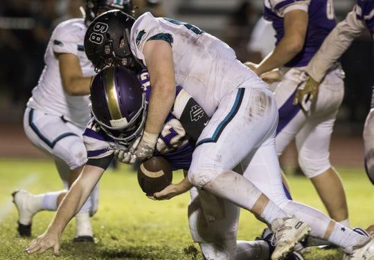 Highland's Cooper Brown sacks Queen Creek quarterback Devin Larsen during their game Friday, Oct. 19, 2018. #azhsfb