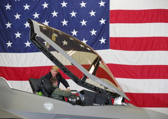 President Trump is shown an F-35 fighter plane during a defense capability and round-table tour at Luke Air Force Base in Glendale on October 19, 2018. Lt. Col. Jason Curtis is the fighter pilot.