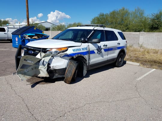 An Arizona Department of Public Safety vehicle was damaged when a trooper intentionally struck a car heading the wrong way on I-10 near Tucson.