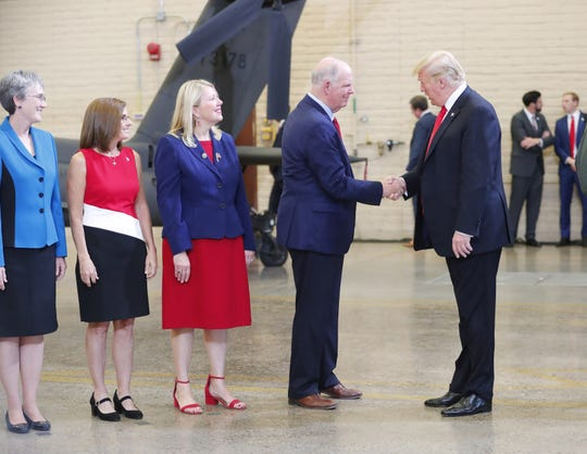 President Trump shakes hands with Rep. Tom O'Halleran, D-Ariz., during a defense capability and round-table tour at Luke Air Force Base in Glendale on October 19, 2018.
