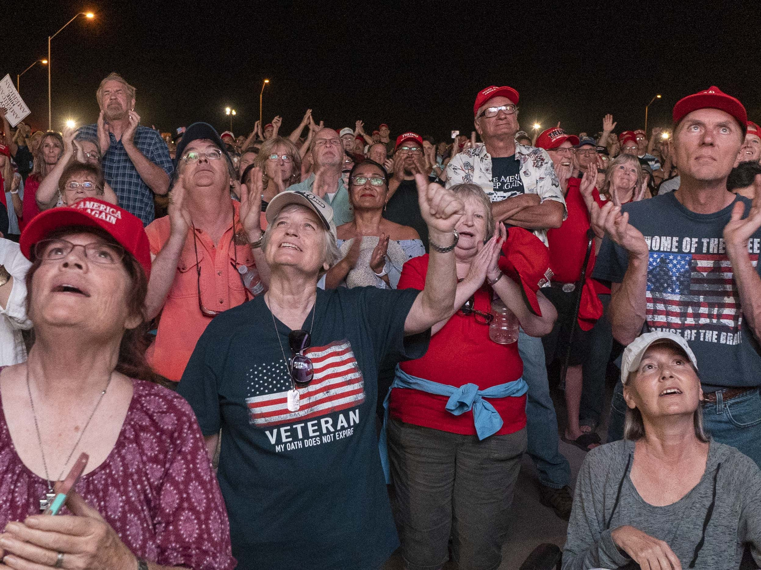 President Donald Trump arrives with Rep. Martha McSally while supporters cheer at Phoenix-Mesa Gateway Airport on Oct. 19, 2018.