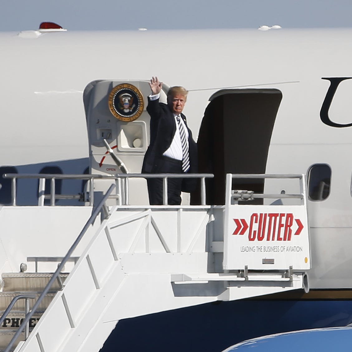 He came, he rallied, he flew away: President Donald Trump's whirlwind trip to Arizona