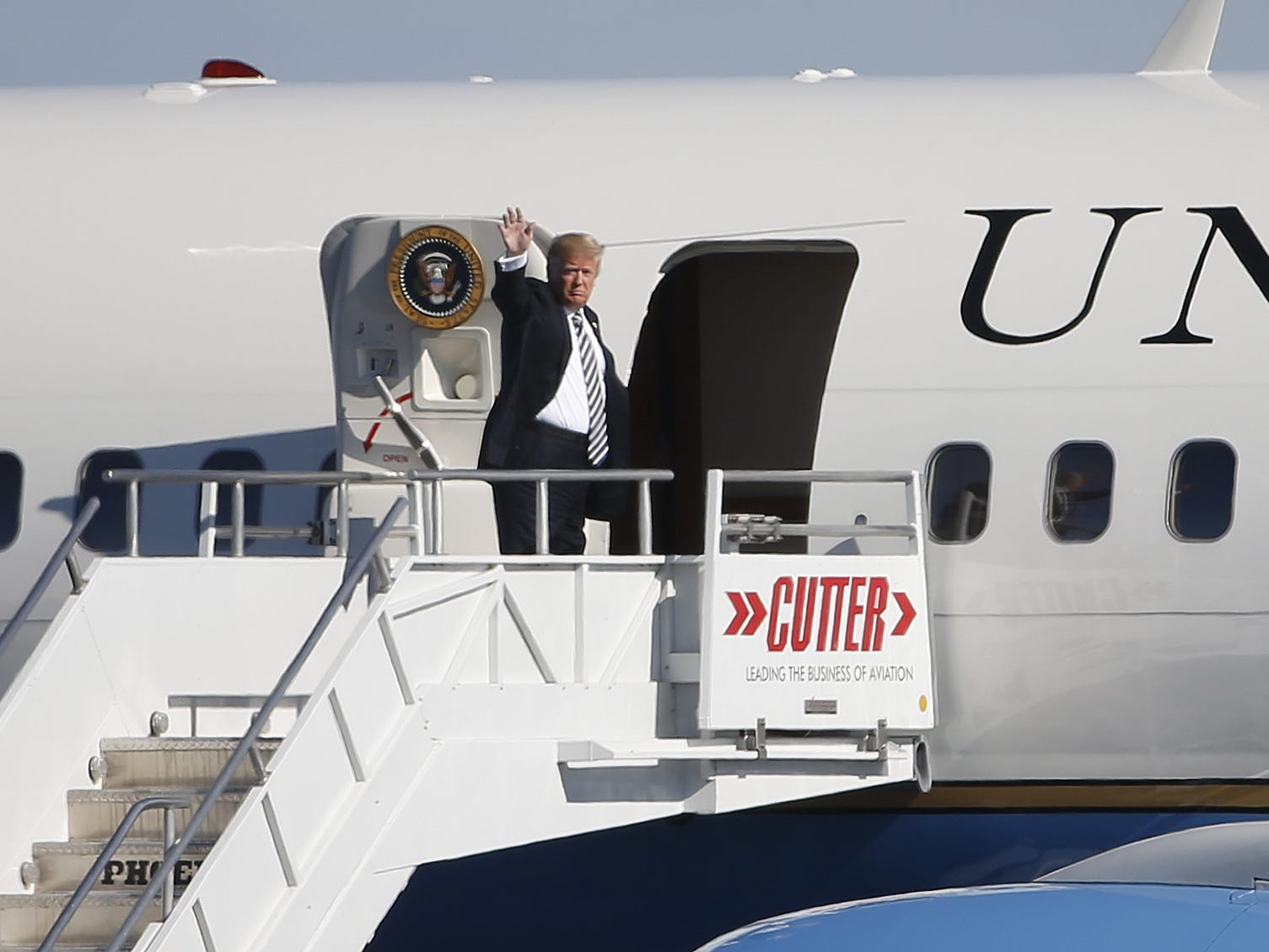 President Donald Trump waves as he boards Air Force Two at Sky Harbor Airport in Phoenix, Ariz. on October 20, 2018.