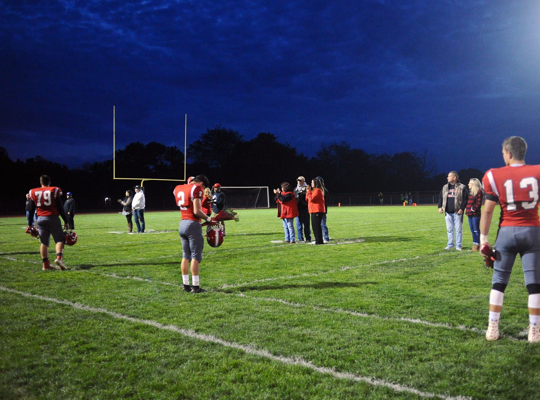 Senior players wait to greet their parents on senior night at Annville Cleona  Friday Oct.19,2018 at Annville Cleona H.S.