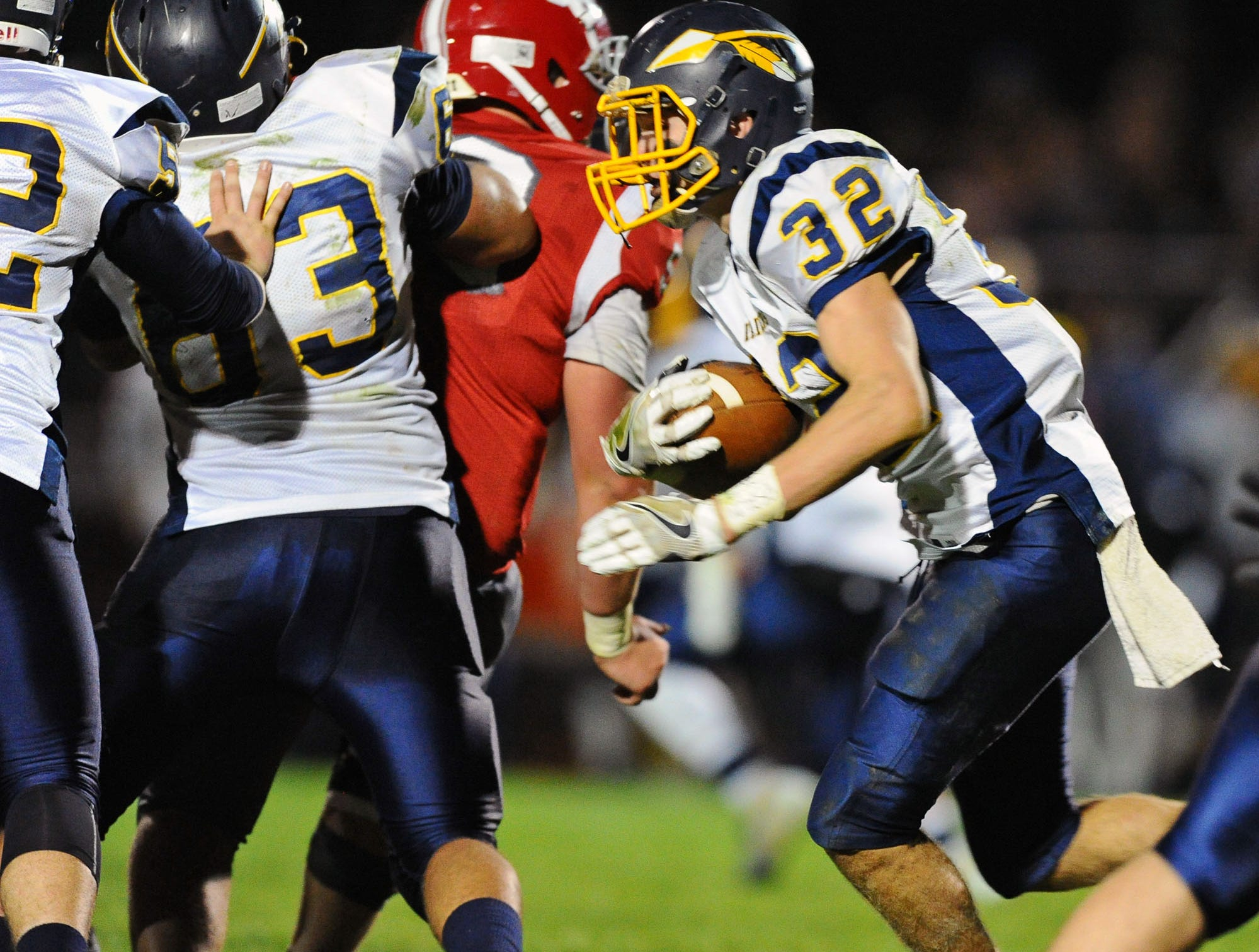 Elco RB Luke Williams(32) looks for running room during first half action.