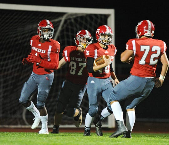 A-C's QB Jeremy Bours (16) is greeted by his teammates Quamir Parker (1) ,Caden Horning (87),and Jaren Bomgardner (72) after he scores his first TD of the night to tie the game at 7-7  in a game played Friday, Oct.19,2018 at Annville Cleona H.S.