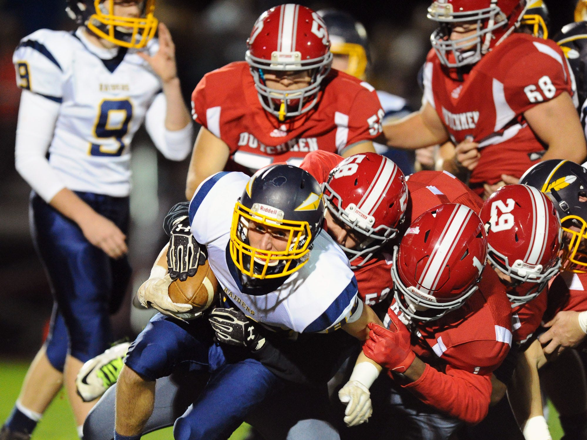 Elco's Evan Huey (88) is stopped by a herd of AC defenders on this first half punt return.