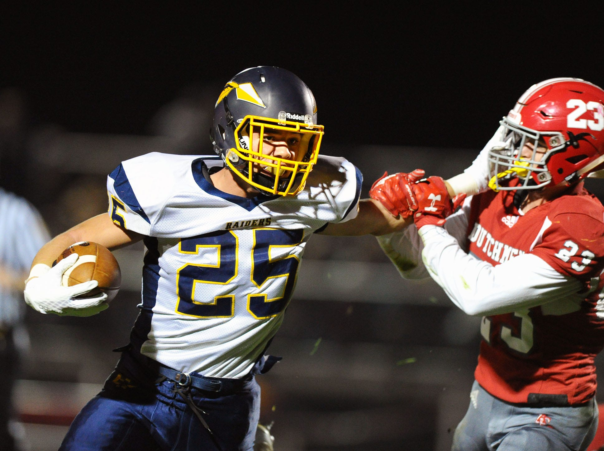 Elco RB Jordan Fernandez (25) holds off A-C's Evan Heilman (23) during this first half run in a game played Friday, Oct.19,2018 at Annville Cleona H.S.