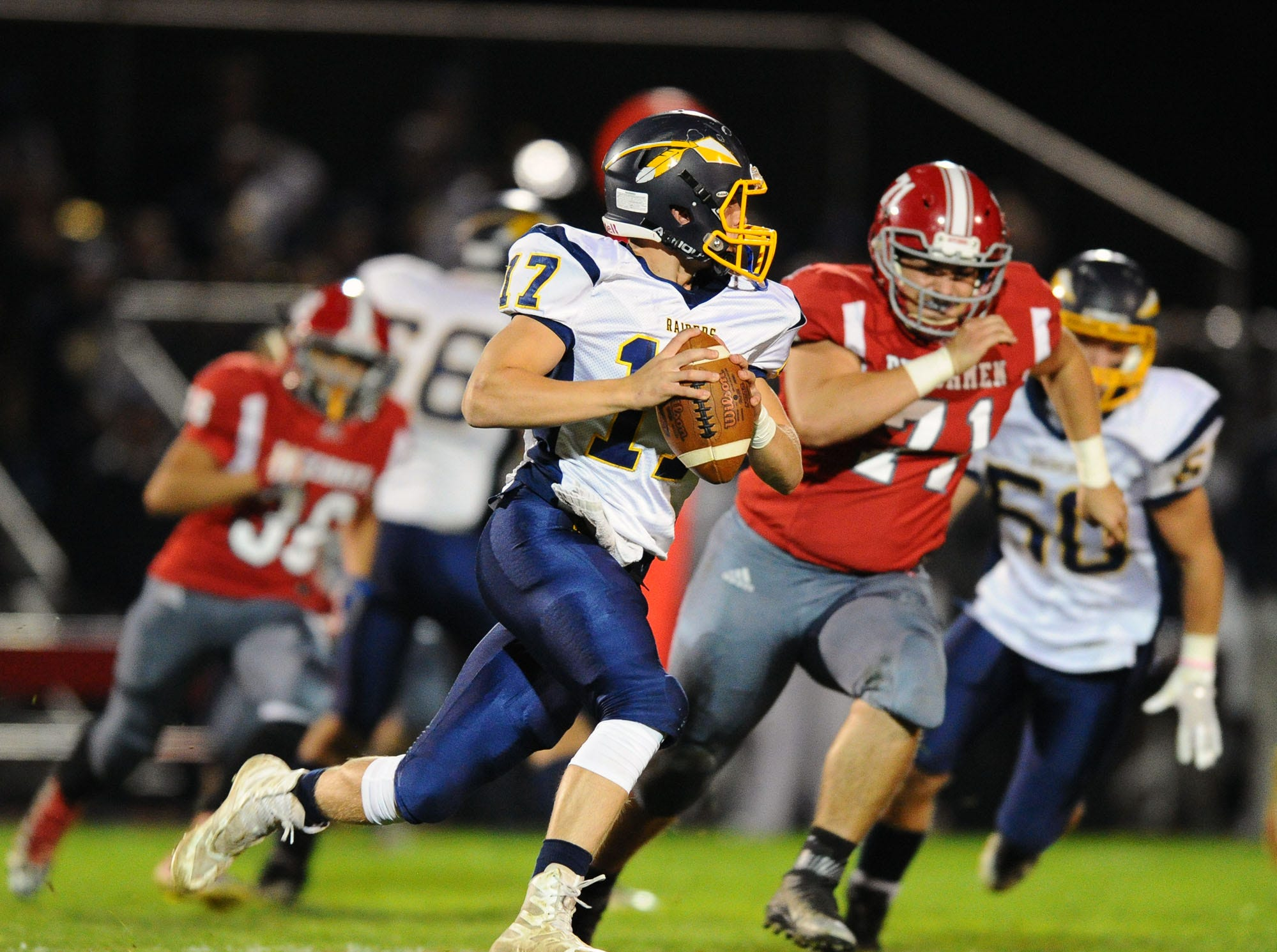 Elco QB Braden Bohannon (17) rolls out as he is chased by AC's Dion Lopez (71) during first half action in a game played Friday, Oct.19,2018 at Annville Cleona H.S.