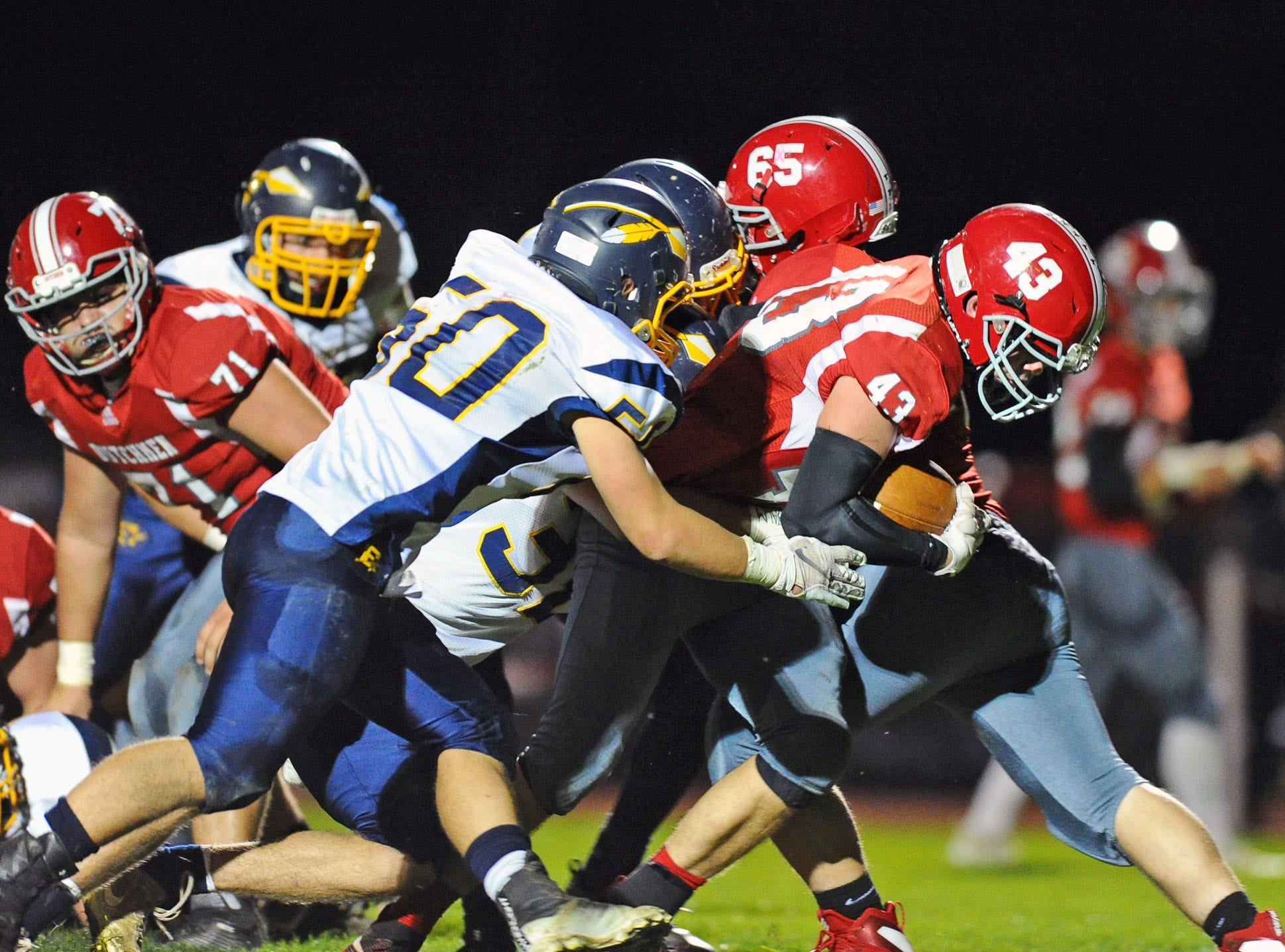 A-C's Trevor Porche (43) bursts through the middle for an A-C first down during first half action.